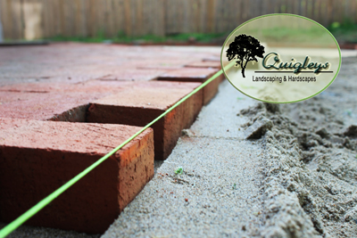 Nashville Brick Paver Patio Company installer of brick paver patios. This is an image of a brick patio being installed.
